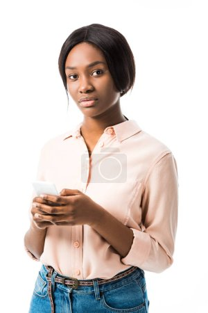 Photo for African american woman in shirt holding smartphone isolated on white - Royalty Free Image
