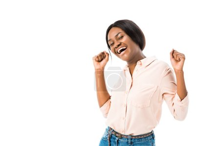 smiling african american woman showing yes gesture and looking at camera isolated on white