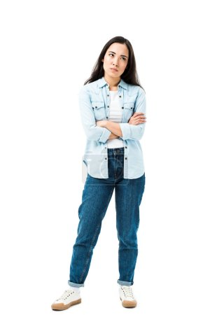 Photo for Attractive and sad asian woman in denim shirt with crossed arms isolated on white - Royalty Free Image