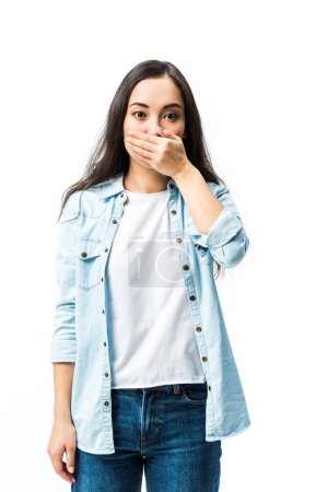 Photo pour Attractive and shocked asian woman in denim shirt obscuring face isolated on white - image libre de droit