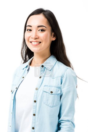 Photo for Attractive and smiling asian woman in denim shirt looking at camera isolated on white - Royalty Free Image