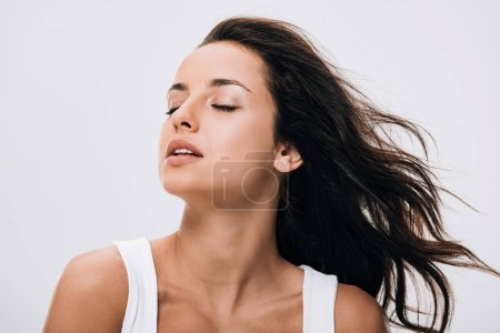 Photo for Brunette beautiful woman with closed eyes and long healthy and shiny hair isolated on grey - Royalty Free Image