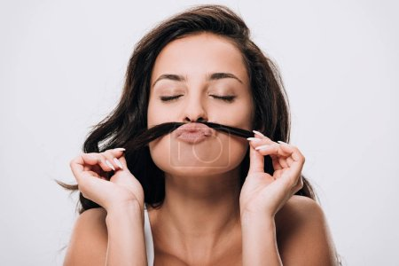 Photo for Brunette beautiful woman with closed eyes making fake mustache from long healthy hair isolated on grey - Royalty Free Image