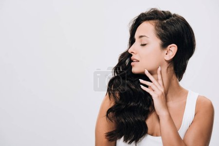 Photo for Brunette beautiful woman with closed eyes and long healthy hair isolated on grey - Royalty Free Image