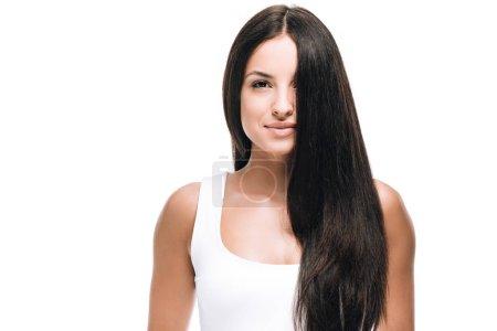 Photo pour Brunette belle femme avec de longs cheveux droits sains et brillants isolés sur blanc - image libre de droit