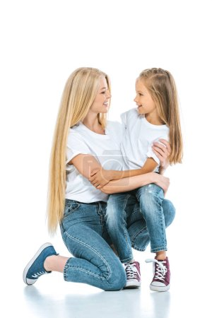 Photo for Happy mother and daughter hugging and looking at each other on white - Royalty Free Image