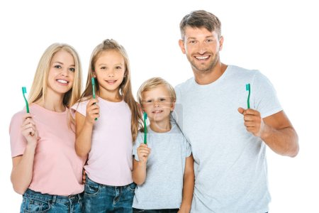 happy parents and kids holding toothbrushes isolated on white