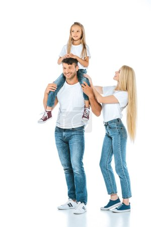 Photo pour Happy father holding on shoulders cute daughter near wife on white - image libre de droit