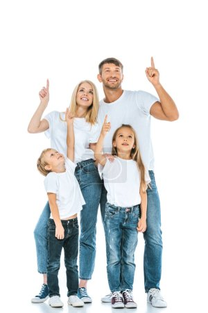 Photo for Happy family looking up and pointing with fingers on white - Royalty Free Image