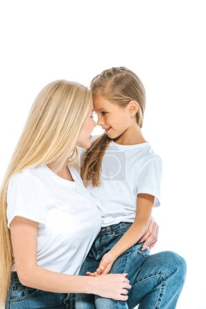 Photo pour Happy mother and preteen daughter looking at each other isolated on white - image libre de droit