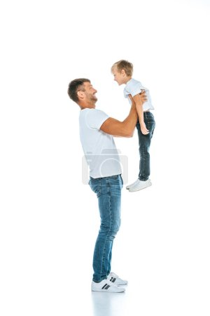 happy dad holding in arms cute son on white