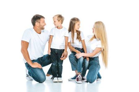 Photo pour Homme heureux regardant fils près de femme et fille sur blanc - image libre de droit