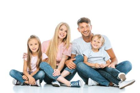 Photo pour Enfants gais assis avec des parents heureux sur blanc - image libre de droit