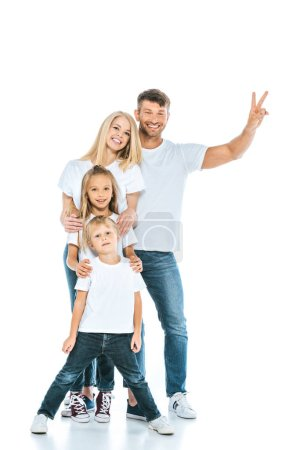 Photo pour Happy man showing peace sign near wife and kids on white - image libre de droit