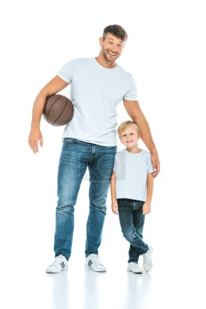 Photo pour Happy father standing with son while holding basketball on white - image libre de droit