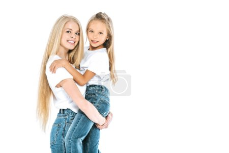 Photo for Cheerful mother holding in arms daughter isolated on white - Royalty Free Image