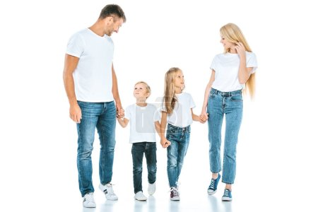 Photo for Happy parents holding hands with cute kids on white - Royalty Free Image