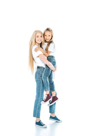 Photo for Happy mother holding in arms cute daughter and standing on white - Royalty Free Image