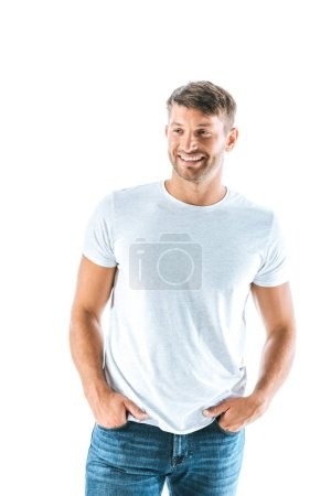 cheerful man standing with hands in pockets isolated on white