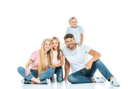 Photo pour Parents heureux et les enfants en jeans bleu denim assis sur blanc - image libre de droit