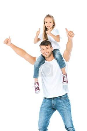 Photo for Happy father holding on shoulders daughter and showing thumbs up isolated on white - Royalty Free Image