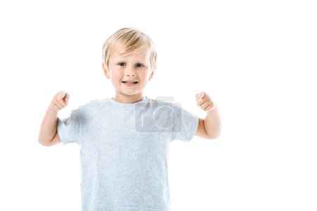 Photo for Happy boy pointing with fingers while looking at camera isolated on white - Royalty Free Image