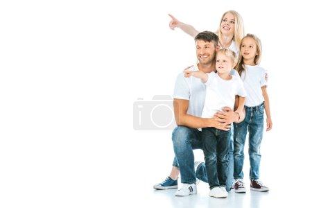Photo pour Famille positive en jeans denim pointant avec les doigts sur blanc - image libre de droit