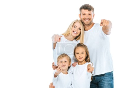 Foto de Positive family in white t-shirts pointing with fingers isolated on white - Imagen libre de derechos