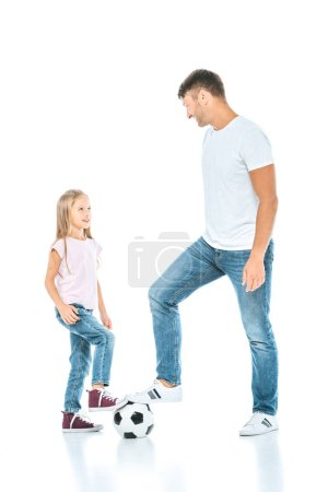 Photo for Happy father playing football with daughter on white - Royalty Free Image