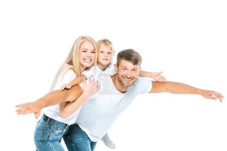Photo pour Heureux père et fils avec les mains tendues près de femme attrayante isolé sur blanc - image libre de droit