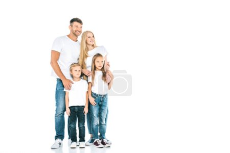 happy family in blue jeans standing on white