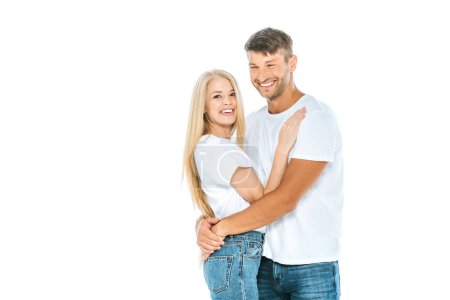 Photo for Happy man laughing while hugging woman isolated on white - Royalty Free Image
