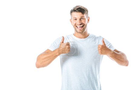Photo for Cheerful and handsome man showing thumbs up isolated on white - Royalty Free Image