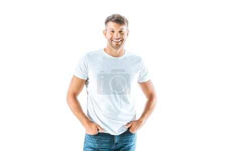Photo for Cheerful and handsome man standing with hands in pockets isolated on white - Royalty Free Image