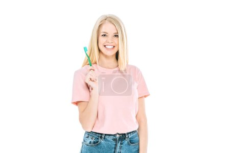 Photo pour Cheerful woman smiling while holding toothbrush isolated on white - image libre de droit