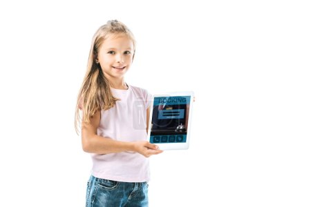 Photo for Cheerful kid holding digital tablet with booking app on screen isolated on white - Royalty Free Image