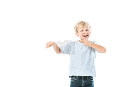 Photo for Excited boy pointing with finger isolated on white - Royalty Free Image