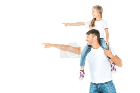 Photo for Happy father holding on shoulders cute daughter and pointing with finger isolated on white - Royalty Free Image