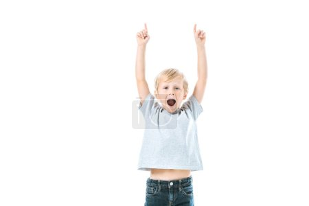 Photo for Excited kid with opened mouth pointing with fingers isolated on white - Royalty Free Image