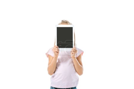 Photo for Kid covering face while holding digital tablet with blank screen isolated on white - Royalty Free Image