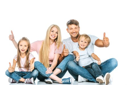 Photo for Happy family sitting and showing thumbs up on white - Royalty Free Image