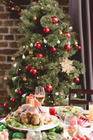 selective focus of wine glass and christmas gift on table