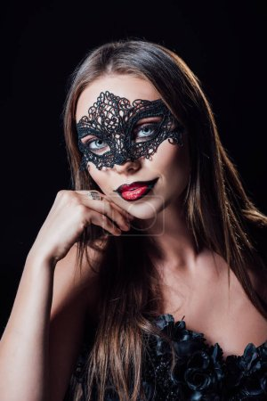 Photo pour Scary vampire girl in black gothic dress and mask isolated on black - image libre de droit