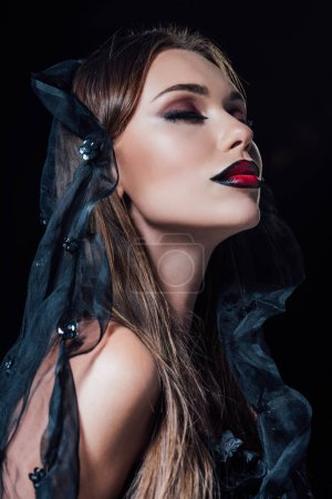 Photo pour Scary vampire girl with closed eyes in black gothic dress and veil isolated on black - image libre de droit