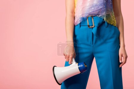 Photo for Cropped view of young stylish disco girl with megaphone isolated on pink - Royalty Free Image