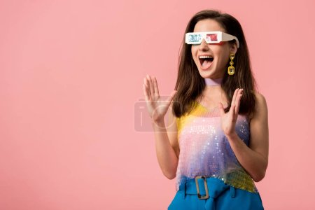 excited young stylish disco girl in 3d glasses isolated on pink