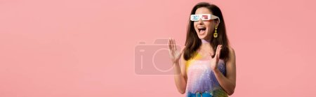 excited young stylish disco girl in 3d glasses isolated on pink, panoramic shot