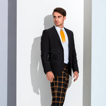Photo for Stylish man in trendy formal wear on white and grey - Royalty Free Image