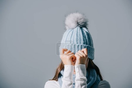 Photo for Stylish woman posing in knitted hat and scarf, isolated on grey - Royalty Free Image