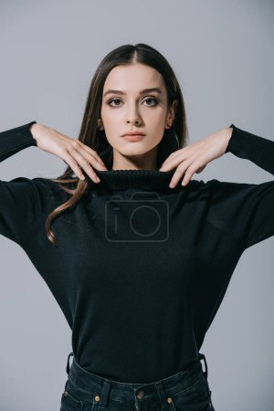 Photo pour Beautiful fashionable woman posing in black sweater, isolated on grey - image libre de droit